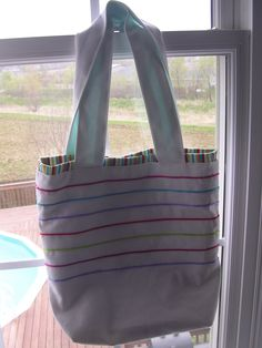 Couched the cording onto a white canvas and lined the inside with stripes for a beach tote.