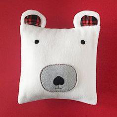Quick and easy to make, this polar bear pillow is the perfect project to whip up before the holidays! Free pattern.