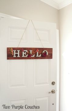 How to make an adorable DIY springtime pallet wood sign for your front door. Also a cute idea for Spring home decor!