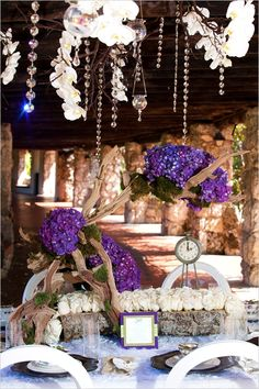 6f56975e694d22 Driftwood and purple flowers are a perfect match for a rustic feel. Wedding  Centerpieces