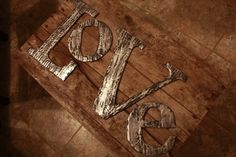 Make your own faux distressed metal – actually cardboard, covered in aluminum foil and buffed with black paint! Kids can write their names, or a favored word like Love, or family.         on December 17, 2012      by homeinterior	      In home interior    distressed metal – actually cardboard, aluminum foil and paint! who knew?