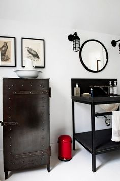 Industrial cabinet and sconces in a bathroom.