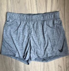 Nike dri-fit training shorts New with tags Heather blue/gray color Size small, adjustable waist They're a loose/oversized fit. Nike Dri Fit Shorts, Workout Shorts, Blue Grey, Gray Color, Nike Women, Training, Tags, Fitness, Outfits