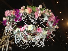 Photos and fab DIY ideas using bulk flowers to create beautiful floral chandeliers and wedding decorations Hanging Centerpiece, Floral Centerpieces, Wedding Centerpieces, Floral Arrangements, Wedding Decorations, Wedding Reception Flowers, Wedding Bouquets, Diy Party Tent, Hawaiian Wedding Themes