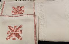 To the left, Spanish Blackstitch, typical Swedish Christmas theme. To the right, beautiful hardanger tablecloth on fine linen.