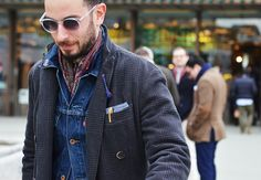 Denim under grey jacket. Bright scarf. (Note: Red and blue kilt pins on lapel.)