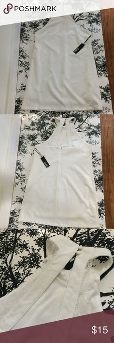 NWT Lulu's white halter dress with back lace. XL White NWT Lulu's halter dress with lace edging detailing on back straps. Fully lined. Lulu's Dresses Midi