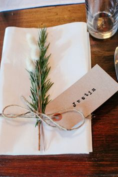 Cost effective way of creating placecards - use kraft tags and twine, and hand stamp guest's name #BarnWeddingIdeas