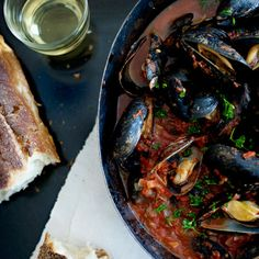 Steamed Mussels with Tomato-and-Garlic Broth Mussels have three things going for them: They're cheap, quick to cook, and delicious. Using clean farmed mussels negates their one big drawback—the tedious chore of scrubbing and debearding. Fish Dishes, Seafood Dishes, Fish And Seafood, Tasty Dishes, Seafood Soup, Wine Recipes, Great Recipes, Cooking Recipes, Favorite Recipes