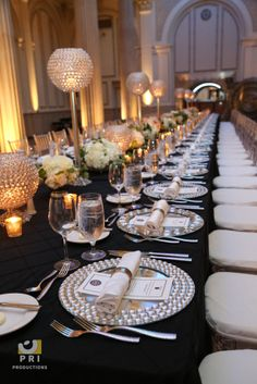 Gorgeous linens and table settings topped off with Chiavari chairs.