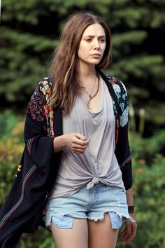 A makeup-free Elizabeth Olsen looks worn out on the set of 'Very Good Girls' in NYC. The newly-brunette actress wears a loose-fitting t-shirt, cut-off jean shorts, and a flowered sweater.
