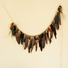 Make This - Feather Garland - Luxe DIY - How Did You Make This? -Looks time-consuming, but sooo pretty!