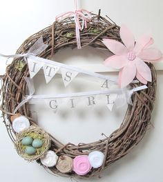 Like how the banner is made on this baby door wreath!