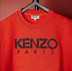 cfdd0c228 Be festive in red this Christmas with the 'Kenzo Paris' logo sweatshirt.