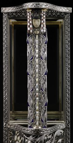 Wittgenstein Vitrine, Carl Otto Czeschka, manufactured by the Wiener Werkstätte, 1908. Silver, moonstone, opal, lapis lazuli, mother-of-pearl, Baroque pearls, onyx, ivory, enamel, glass, ebony veneers, 66.25 in. H. | Collection of the Dallas Museum of Art