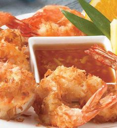 Recipe for Copy Cat Outback Steakhouse Coconut Shrimp - These are tender crispy shrimp with a light flaky coconut coating on the outside. They offer just the right amount of sweetness and taste delicious with the tangy tart flavors that come in the Creole Marmalade.