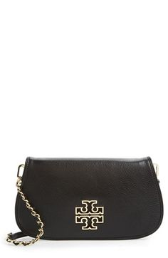 Free shipping and returns on Tory Burch 'Britten' Convertible Clutch at Nordstrom.com. A goldtone logo shines on the streamlined vintage profile of a pebbled leather clutch furnished with an optional chain-woven strap that offers hands-free versatility.