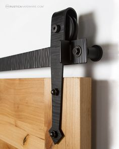 Blacksmithing techniques give this a rustic and old world look. http://rusticahardware.com/hammered-arrow-barn-door-hardware/