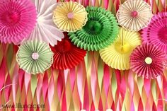 This Tissue Fan and Crepe Paper backdrop will make the perfect backdrop for your next baby shower. @HUGGIES Baby Shower Planner
