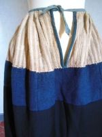 Wool under petticoat with cotton or linen top section. French. Dyed with indigo.