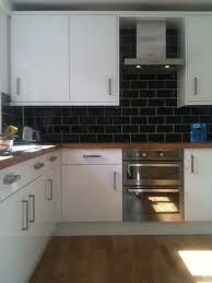 18 black subway tiles in modern kitchen design ideas black subway black tiles with white high gloss kitchen ppazfo