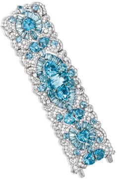 Platinum, Aquamarine and Diamond Bracelet, Circa 1935. The wide openwork strap of scroll and geometric design set with heart-shaped, oval, tapered baguette, round and bullet-shaped aquamarines weighing approximately 145.00 carats, within a ground of round and single-cut diamonds weighing approximately 50.00 carats, length 7 inches, possibly Paul Flato.