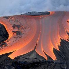 Kilauea Volcano (home of Madame Pele, Goddess of Fire) Description: A river of lava entering the Pacific Ocean.