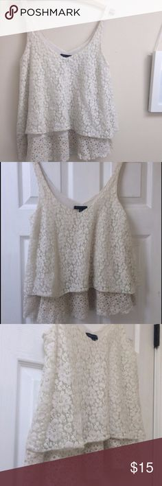 American Eagle tiered flowy lace tank top Flattering American Eagle lace flowy tank top, EUC. Slightly off white color. Can fit size small too. American Eagle Outfitters Tops Tank Tops