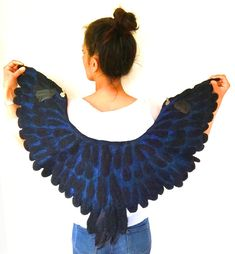 Mimicking the black raven feathers with the blue sheen to create this stunning winged cape. Embellished with real raven feather detailing. Raven Feather, Raven Wings, Wing Collar, Wearable Art, Trending Outfits, Feathers, Cape, Unique Jewelry, Felt