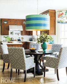 Kitchen Eating Area by Hudson Interior Designs with a custom #straydogdesigns Bufta Big Light.