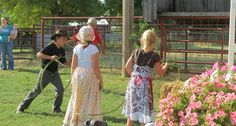 """Young guests at the church barbecue try their luck at roping the """"steer"""" on the west wide of the Courtyard Pole Barn at Westwoods' Civil War Ranch. (Pictures by Lena & Leif Baron)"""