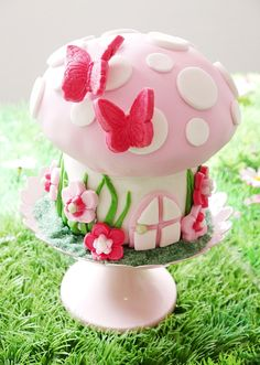 """""""A beautiful homemade cake in the shape of a toadstool was the crowning glory of the table and a centerpiece in itself,"""" Bird says. """"It wowed the little fairies. No need for elaborate desserts buffet here!""""   Source: Bird's Party"""