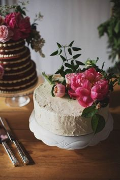 simple wedding cake with fresh flower topper