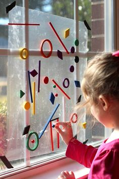 Contact paper, sticky side out, and plastic shapes....so simple and wonderfully engaging for kids!!! stickysplgbn.jpg