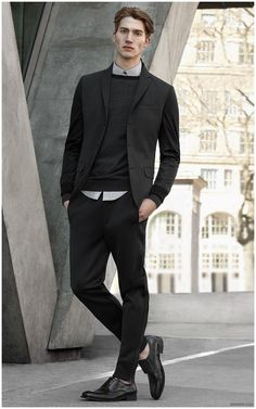 Kenneth Cole unveils a dark fall-winter 2015 menswear outing, geared  towards the fashionable urbanite.