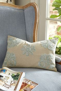 Another wonderful way to add a layer of texture and pattern to the bed, sofa or your favorite reading chair, this charming pillow is embellished crewel-embroidered florals using two-toned yarns for a soft, tweeded look. Embroidered on a natural-hued ground of woven cotton, it comes with a lofty poly insert. Brighton Crewel Pillow - Item #6AF94