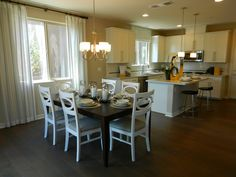 Beautiful kitchen and dining room in the Lillian model by Richmond American Homes in Cadence. Richmond American Homes, Kitchen Dining, Dining Room, Beautiful Kitchens, Backyard, Restaurant, How To Plan, Table, Model