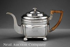 """A Kentucky Coin Silver Teapot, Asa Blanchard, Lexington, KY, wc. 1808-1838, marked """"A·BLANCHARD"""" in rectangle, paneled rectangular body with molded collar and ball feet, squared wood handle, domed cover with square mushroom finial, period script monogram, height 6 3/4 in"""