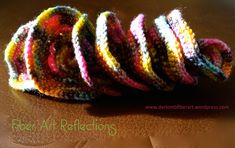 Hyperbolic Crochet Tutorial: The Expanding Spiral All of the photos below are of the same hyperbolic crochet piece. What I love about this particular form is that it can be twisted, folded, and s… Crochet Ruffle, Freeform Crochet, Crochet Stitches, Sock Yarn, Handicraft, Fiber Art, Weaving, Spirals, Creative