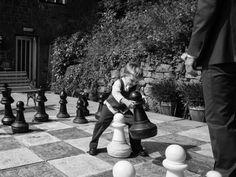 Boy plays chess at a Caer Llan wedding