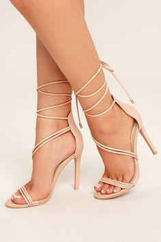 Be the princess you were born to be in the Ameerah Blush Lace-Up Heels! From a peep-toe upper, vegan leather straps create a sexy, asymmetrical upper with long tying laces (and gold aglets).