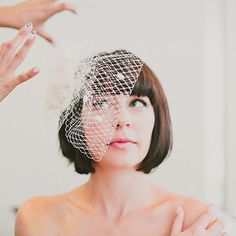 Brides.com: Wedding Hairstyles for Brides with Short Hair. A Bobbed Hairstyle With Full Bangs  The birdcage veil does it again! This time, it's offset so the bride can showcase her perfectly-trimmed bangs and gorgeous makeup. It's a fab look for a modern, downtown wedding.  See more modern wedding hairstyles.