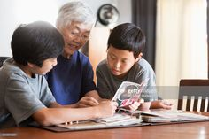Stock Photo : Asian grandmother and grandsons looking at photo album Royalty Free Images, Asian, Album, Stock Photos, Lifestyle, Photography, Photograph, Fotografie, Photoshoot
