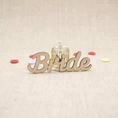 MDF wooden bride word shape laser cut from Premium 3mm MDF (Medium Density Fibreboard). Sizes from 3cm to 6cm tall in 3mm thickness.