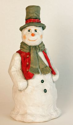 Mr Snowman, Handcarved by Susan L Hendrix, Wasatch Woodcarver.  A Gerald Sears Roughout.  I live in the foothills in Utah, at the base of the Wasatch Range. Carving and teaching carving, are two of my passions.