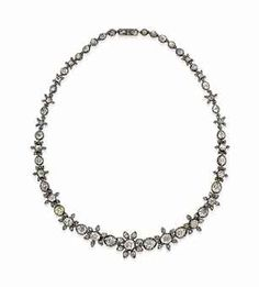 AN EARLY 19TH CENTURY DIAMOND NECKLACE Designed as series of rose-cut diamond flowerhead clusters, interspersed by similarly-set collet spacer links, to a concealed clasp, closed-set in silver and gold, circa 1810.