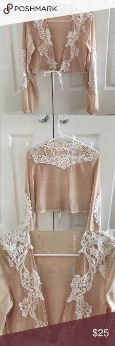 For love and lemons style wrap top Nude mesh and white lace wrap/top. NOT for love and lemons but it is a similar style. Brand is Luxxel from Akira Chicago. Worn once in great condition. For Love and Lemons Tops Blouses