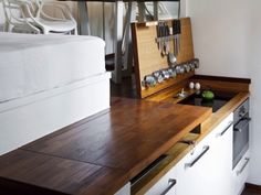 Here's another way to hide the kitchen: put it under the floor