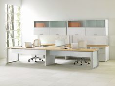 Teknion Expansion Desking. Great combination of overhead storage styles along with under worksurface storage as well.