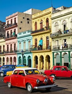 A Design Lover's Guide To Cuba Standards of the Havana streetscape—arcaded pastel buildings and brightly colored American automobiles. Vinales, Santa Lucia, Belize, The Places Youll Go, Places To Visit, Carros Vintage, Cuban Cars, Trinidad E Tobago, Cuba Fashion